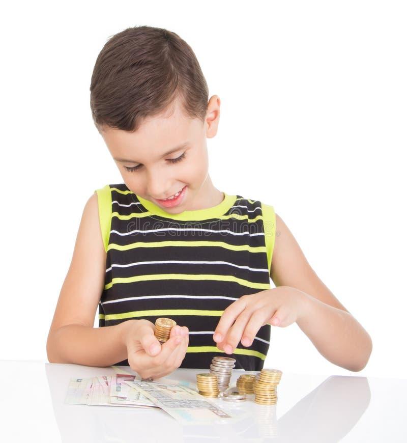 Jonge jongen die zijn geld gelukkig tellen royalty-vrije stock afbeeldingen