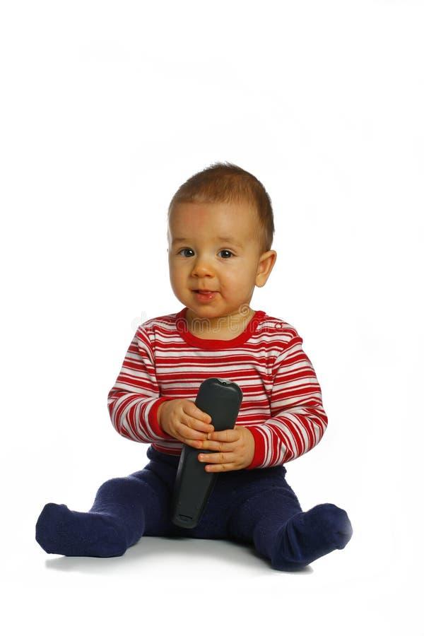 Jonge jongen met afstandsbediening stock foto