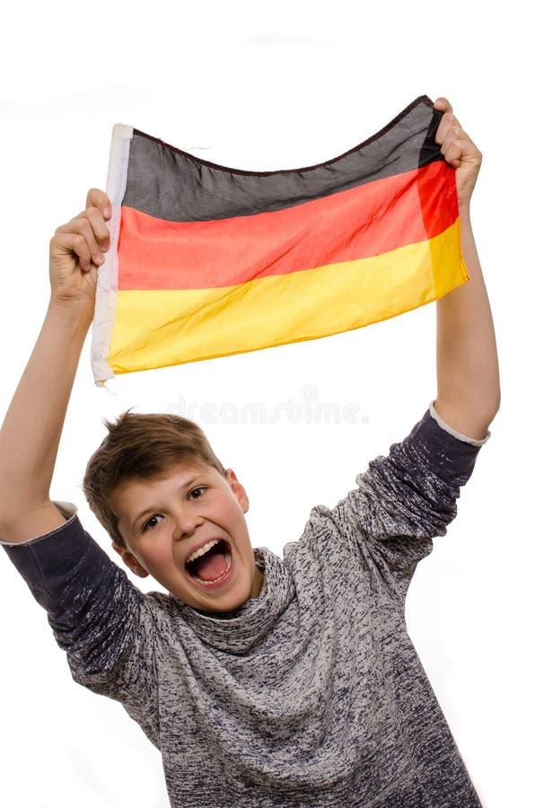Jonge jongen met een Duitse vlag stock afbeeldingen