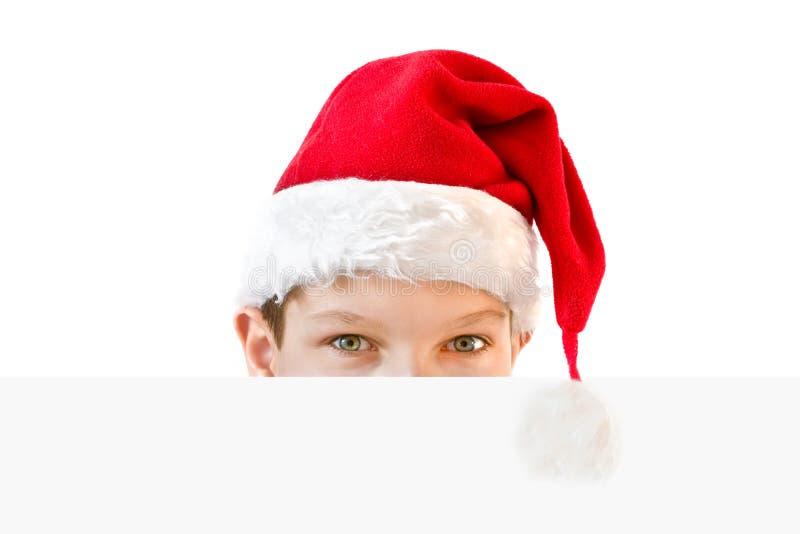 Jonge jongen in rode Kerstmanhoed royalty-vrije stock fotografie