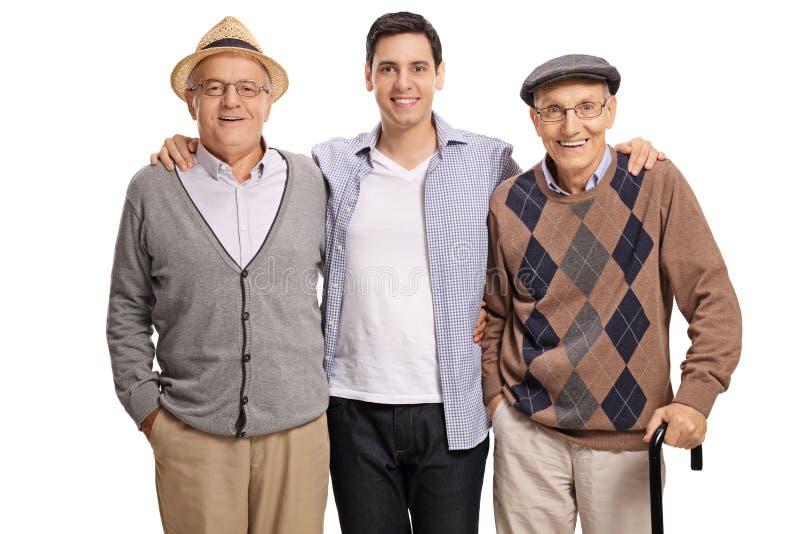 Jonge kerel met twee bejaarden stock afbeelding