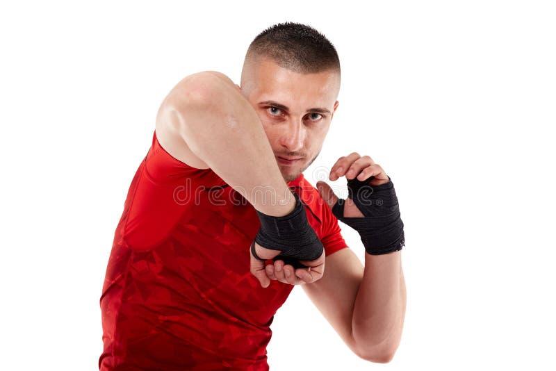 Jonge kickboxvechter op wit royalty-vrije stock foto's