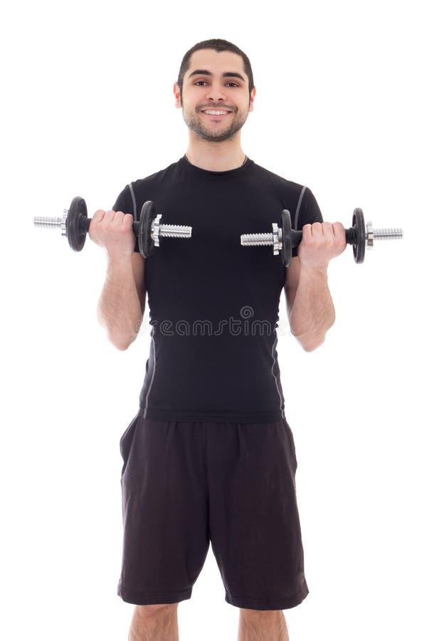 Jonge knappe Arabische mens in sportkleding die oefeningen met dum doen stock foto's
