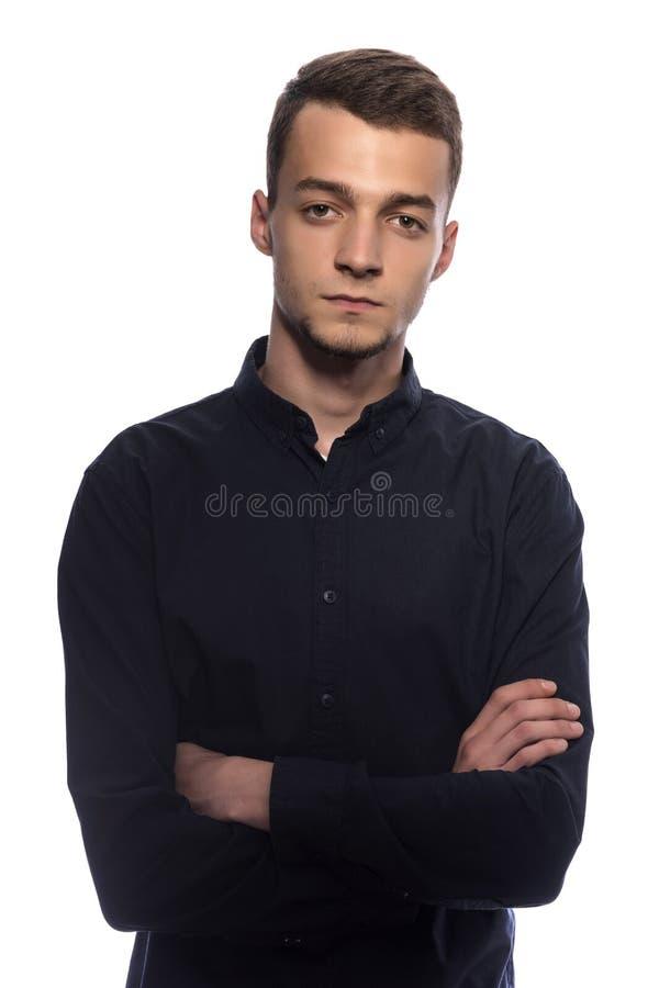 Jonge knappe mens in een donker overhemd royalty-vrije stock afbeeldingen