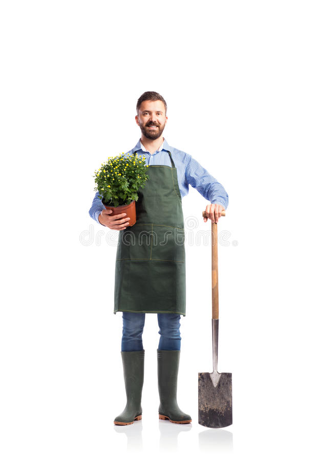 Jonge knappe tuinman stock afbeelding