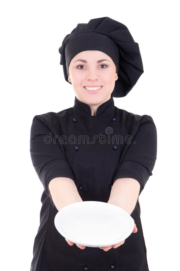 Jonge kokvrouw in zwarte eenvormig met lege die plaat op w wordt geïsoleerd royalty-vrije stock foto's