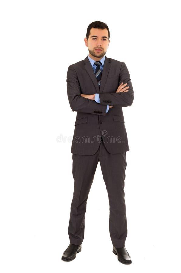 Jonge Latijnse mens die dragend grijs kostuum bevinden zich stock afbeelding