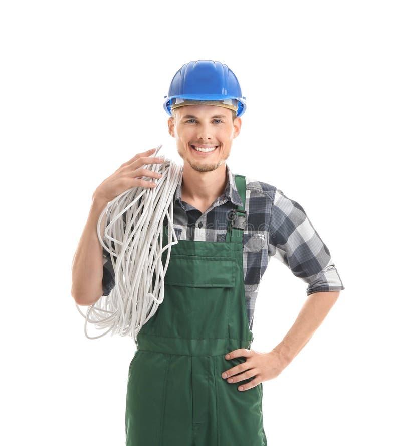 Jonge mannelijke elektricien op witte achtergrond stock afbeeldingen