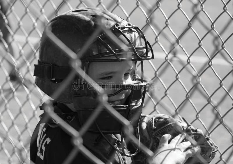 Jonge mannelijke honkbalspeler stock afbeelding