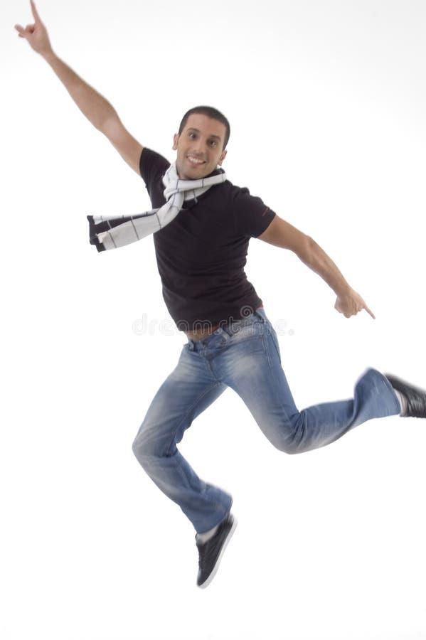 Jonge mannelijke sprongen in lucht stock fotografie