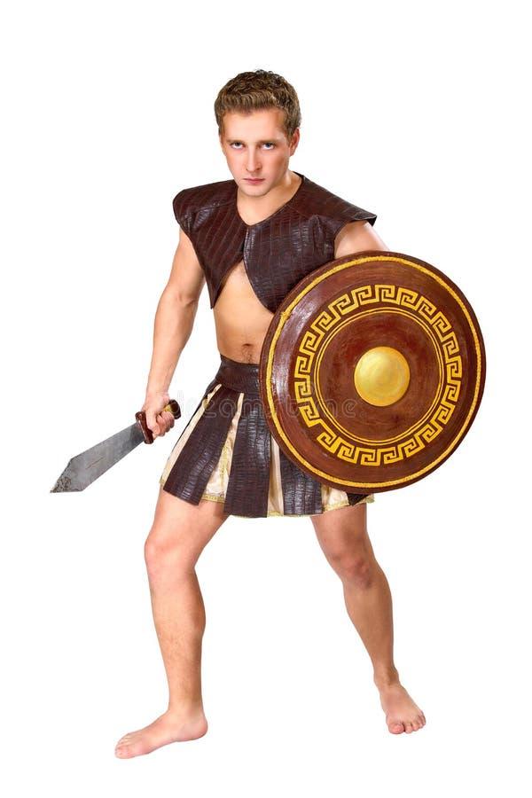 Jonge mannelijke strijder met een schild stock afbeeldingen