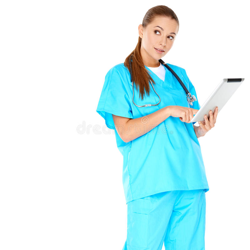 Jonge Medische Arts Using Tablet Device stock afbeeldingen