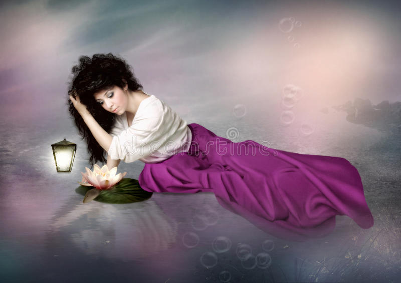 Jonge meisje en waterlelie stock foto