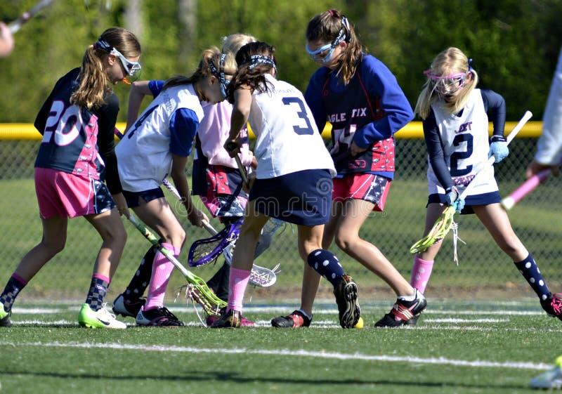 Jonge Meisjeslacrosse stock afbeeldingen