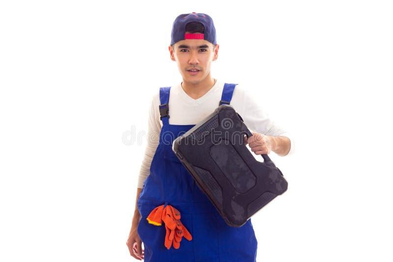 Jonge mens in algemene holdingstoolbox stock afbeeldingen