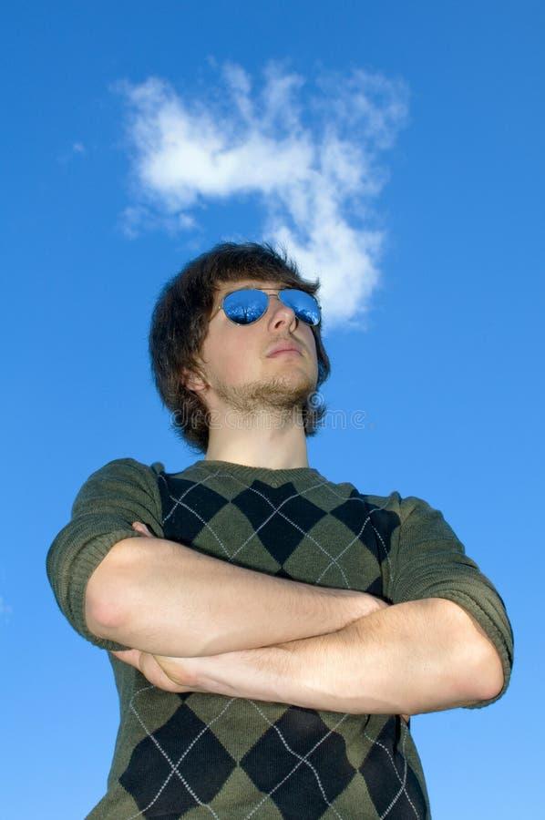 Jonge mens in blauwe glazen stock foto's
