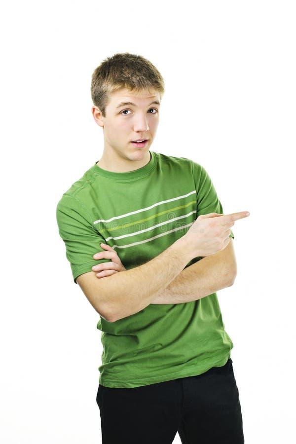 Jonge mens die aan de kant richt stock foto's