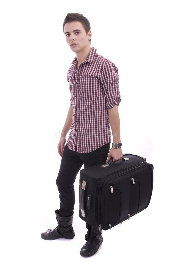 Jonge mens die bij luchthaven wacht stock afbeeldingen