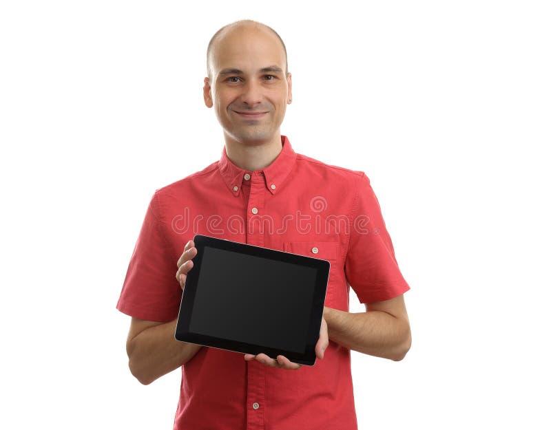 Jonge mens die een Tabletpc houden stock foto