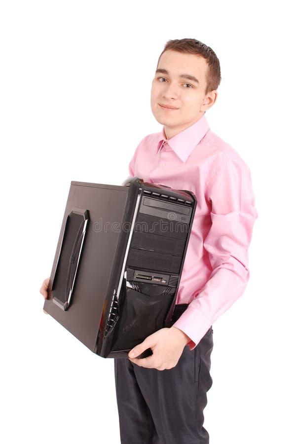 Jonge mens die een witte achtergrond van PC met zachte schaduw houden royalty-vrije stock foto