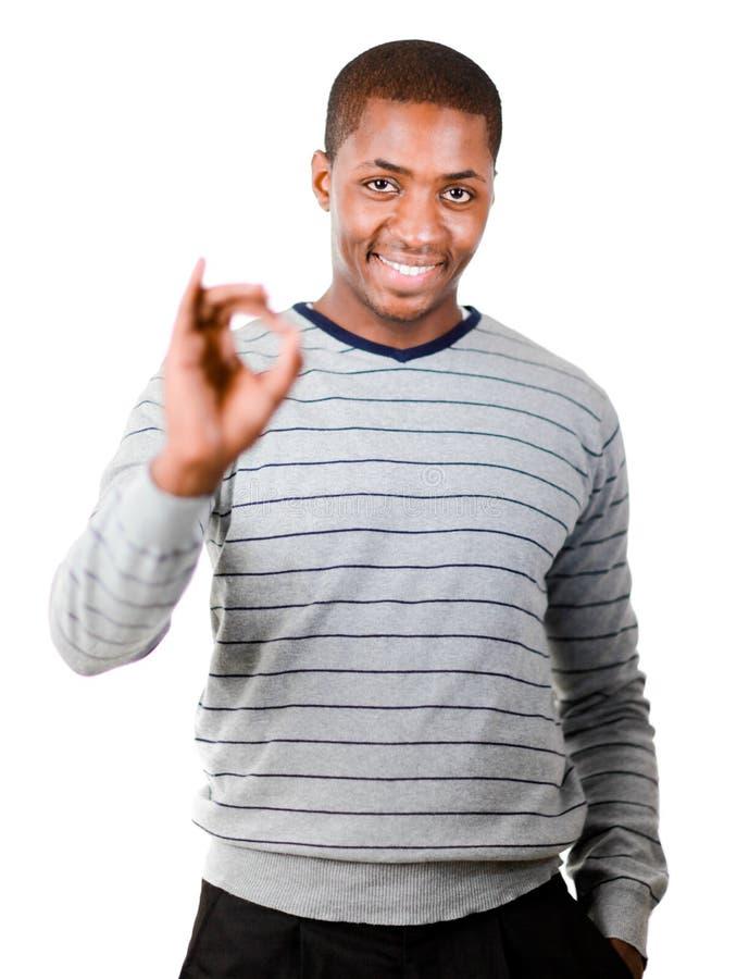 Jonge mens die het o.k. teken geeft royalty-vrije stock afbeeldingen