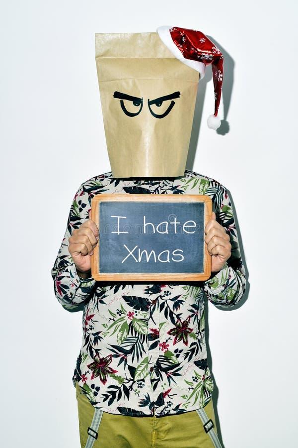 Jonge mens die Kerstmis haat royalty-vrije stock fotografie