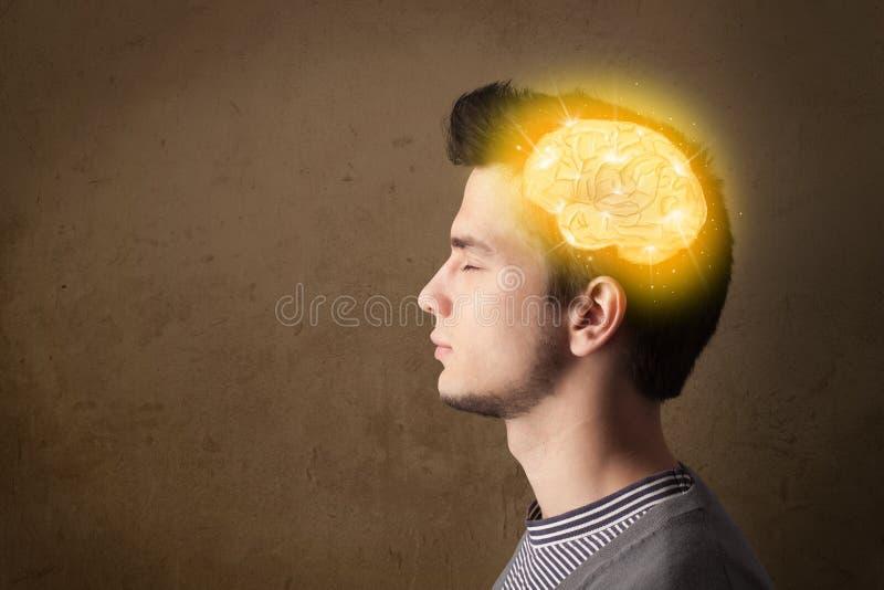 Jonge mens die met gloeiende hersenenillustratie denken stock fotografie