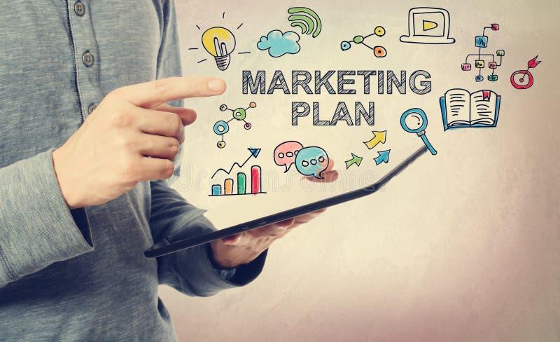 Jonge mens die op Marketing Planconcept richten stock afbeeldingen