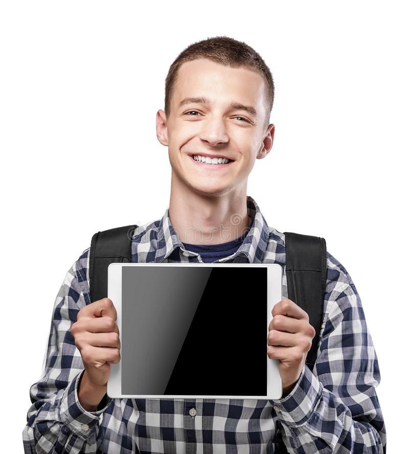 Jonge mens die tabletpc met behulp van royalty-vrije stock afbeelding