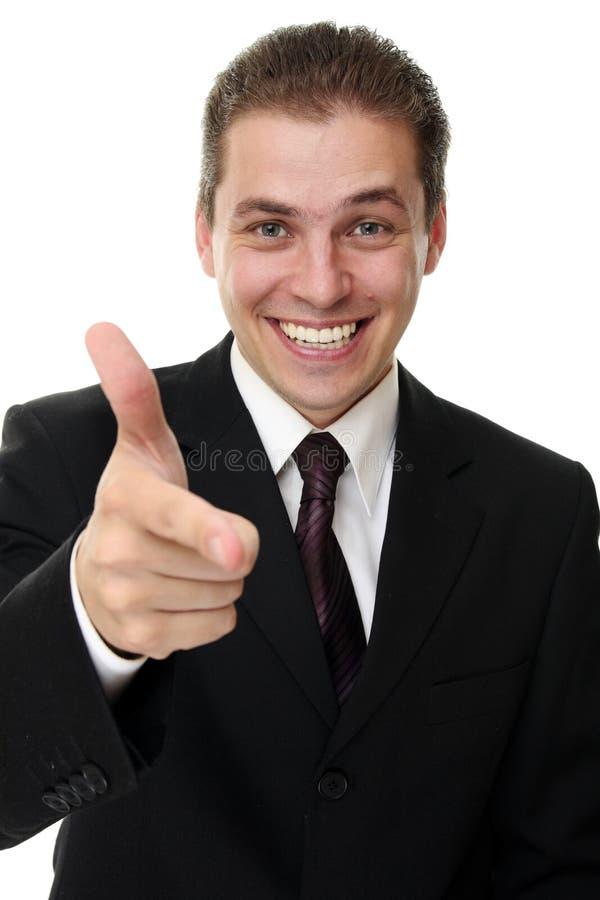 Jonge mens die zijn vinger naar buiten naar u richt stock afbeeldingen