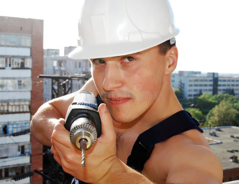 Jonge mens in een eenvormige bouwer. stock foto's
