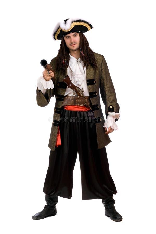 Jonge mens in een piraatkostuum met pistool royalty-vrije stock foto