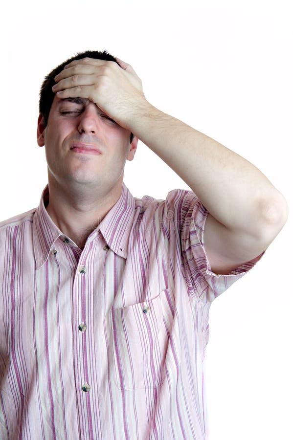 Jonge mens en hoofdpijn stock afbeelding