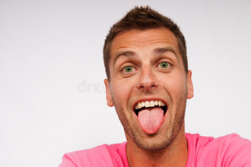 Jonge mens en zijn tong royalty-vrije stock afbeeldingen