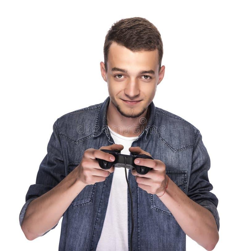 Jonge mens het spelen op console of computer stock foto's