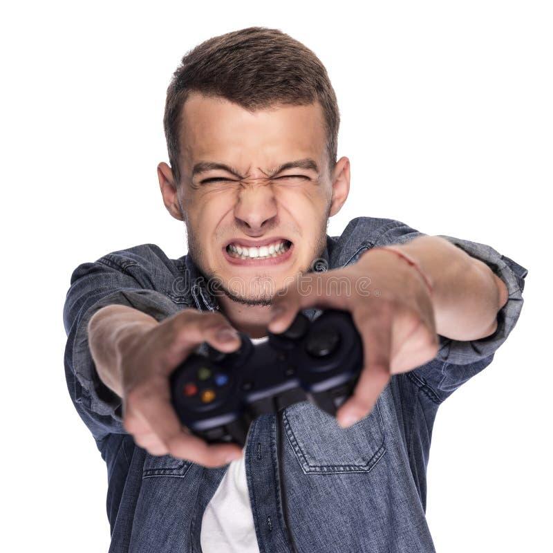 Jonge mens het spelen op console of computer royalty-vrije stock foto