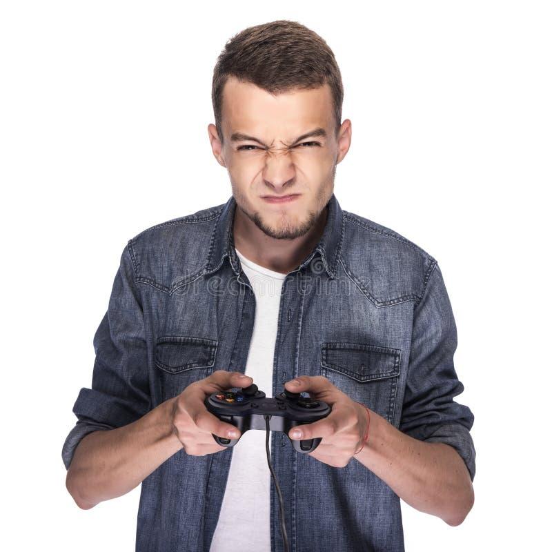Jonge mens het spelen op console of computer stock foto