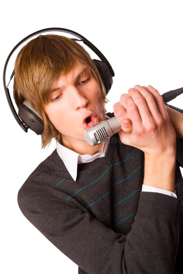 Jonge mens het zingen stock foto
