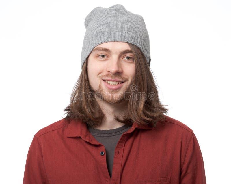 Jonge mens in hoeden dichte omhooggaand stock fotografie