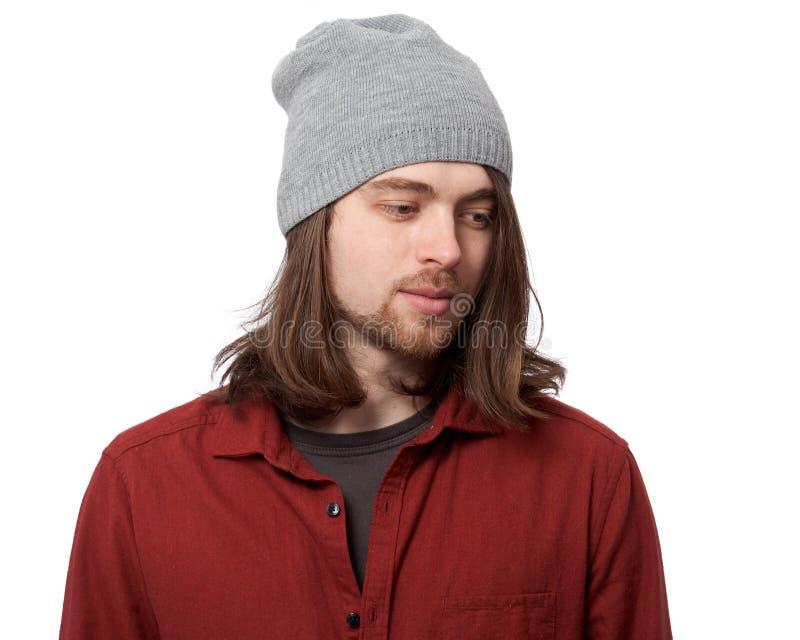 Jonge mens in hoeden dichte omhooggaand royalty-vrije stock afbeelding