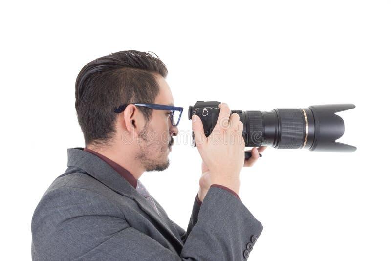 Jonge mens in kostuum die een foto met beroeps nemen stock afbeeldingen