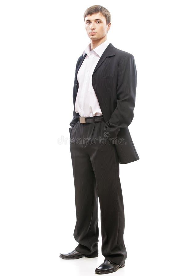 Jonge mens in kostuumhoogtepunt stock foto's