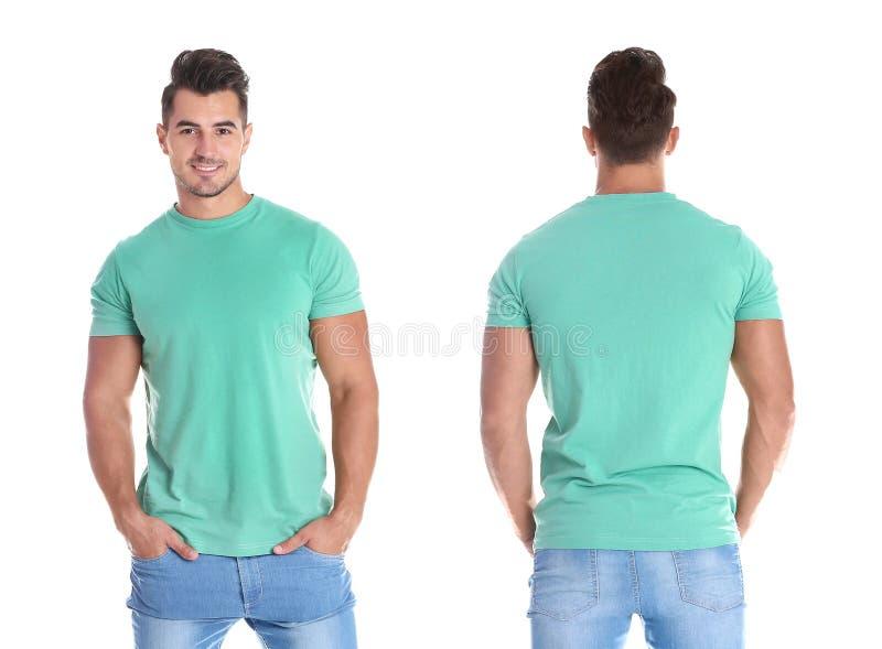 Jonge mens in lege groene t-shirt op witte achtergrond stock afbeeldingen
