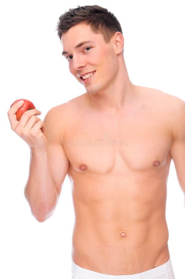 Jonge mens met appel stock afbeelding