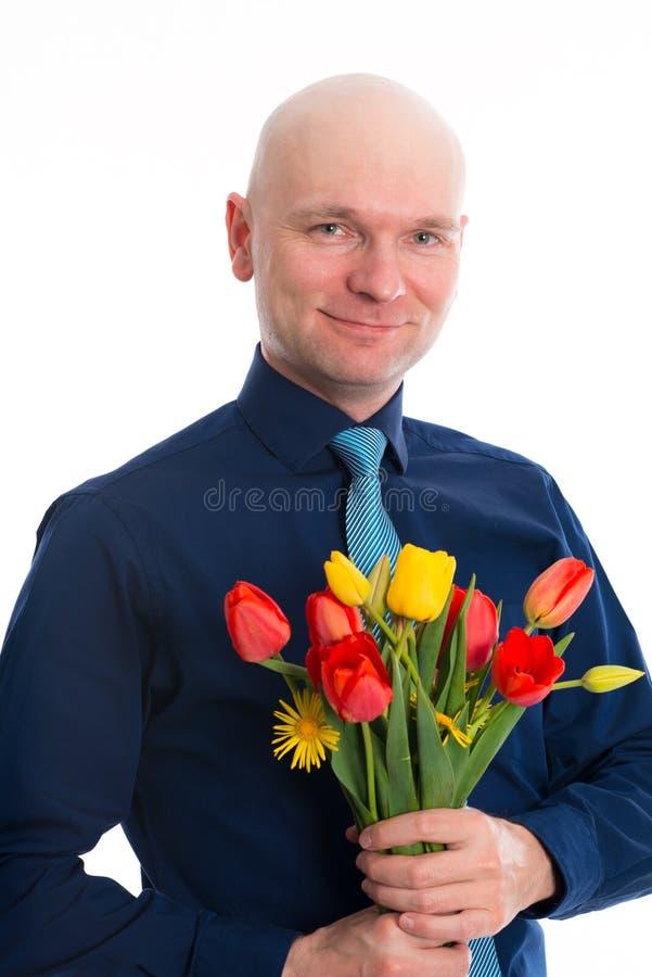 Jonge mens met bos van tulpen stock afbeeldingen