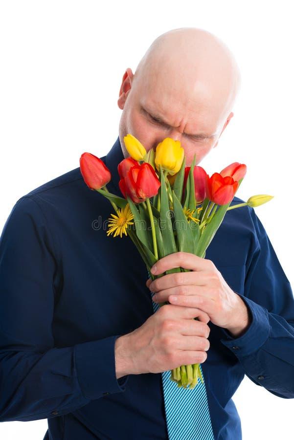 Jonge mens met bos van tulpen royalty-vrije stock afbeelding
