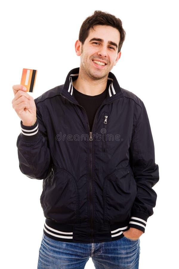 Jonge mens met creditcard stock foto