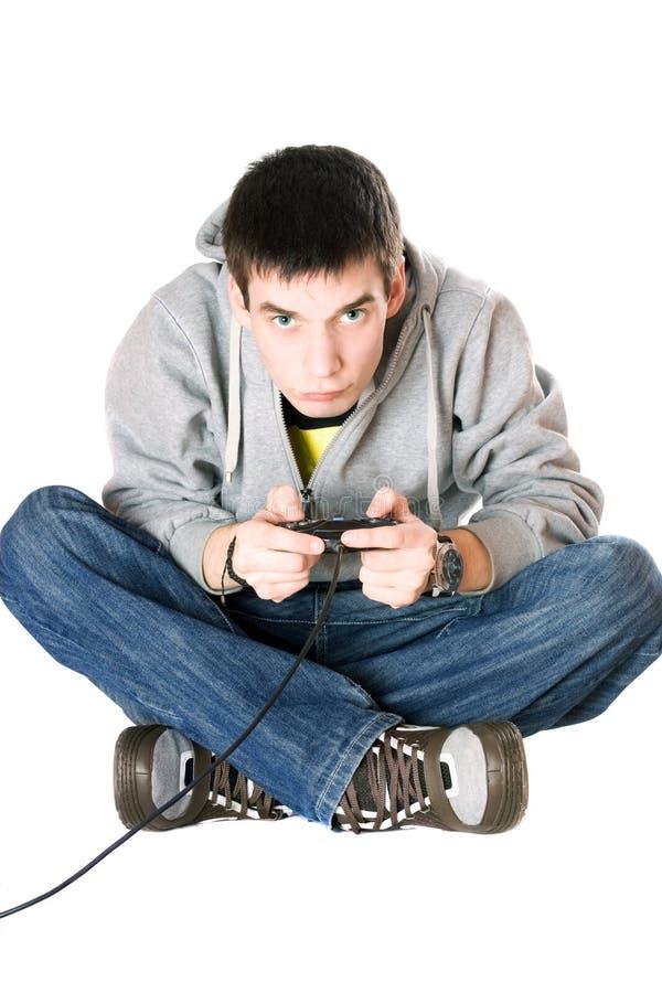 Jonge mens met een bedieningshendel stock foto's