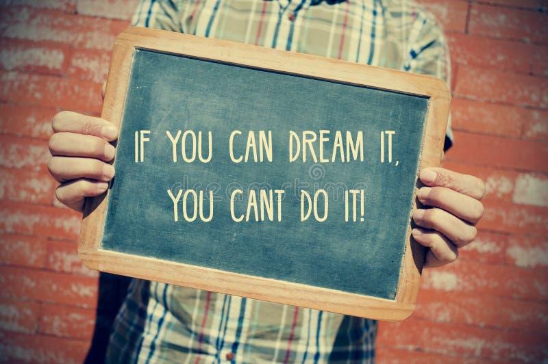 Jonge mens met een bord met de tekst als u het, y kunt dromen stock afbeelding