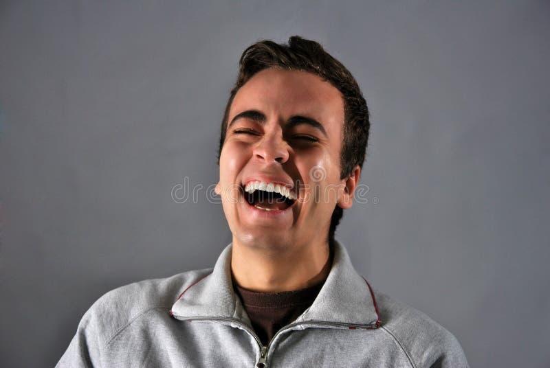 Jonge mens met gelukkige uitdrukking stock afbeeldingen
